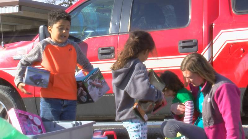 Burkburnett Volunteer Fire Department firefighters hid gifts from the Grinch so only...