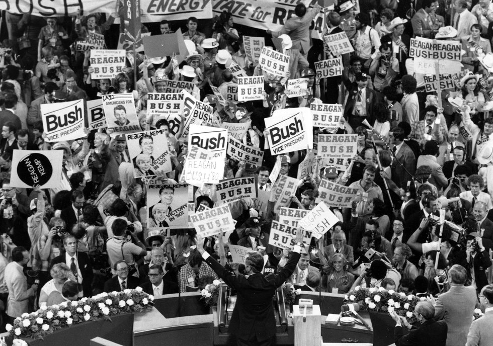 In this July 16, 1980 photo George H.W. Bush, center foreground, acknowledges the crowd before...