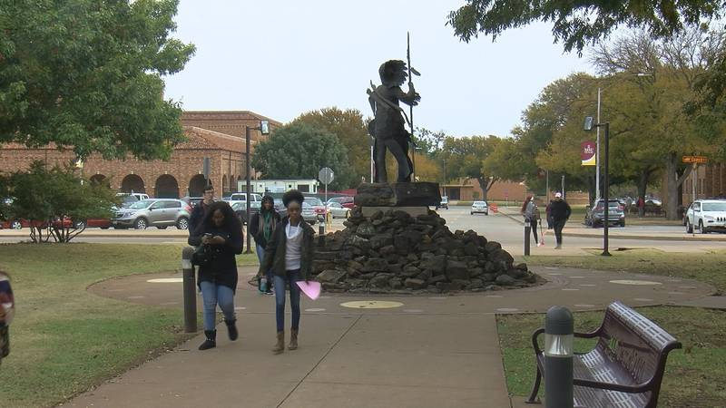 Students walk outside between classes.