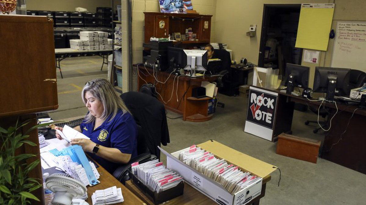 In this Monday, April 20, 2020 photo, inventory clerk Teresa Barajas, left, and warehouse...