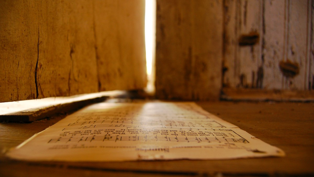An example of Rice's work. Hymns, including this one titled Sunrise, are strewn about in the...