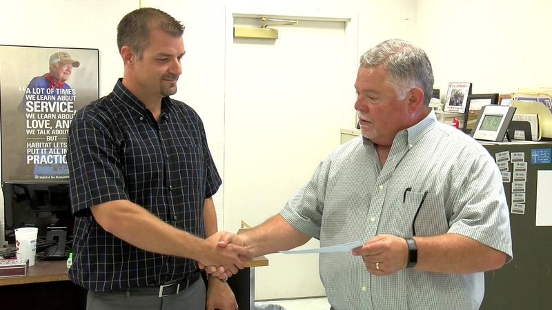 Proceeds from the Parade of Homes were presented to Habitat for Humanity on Thursday.