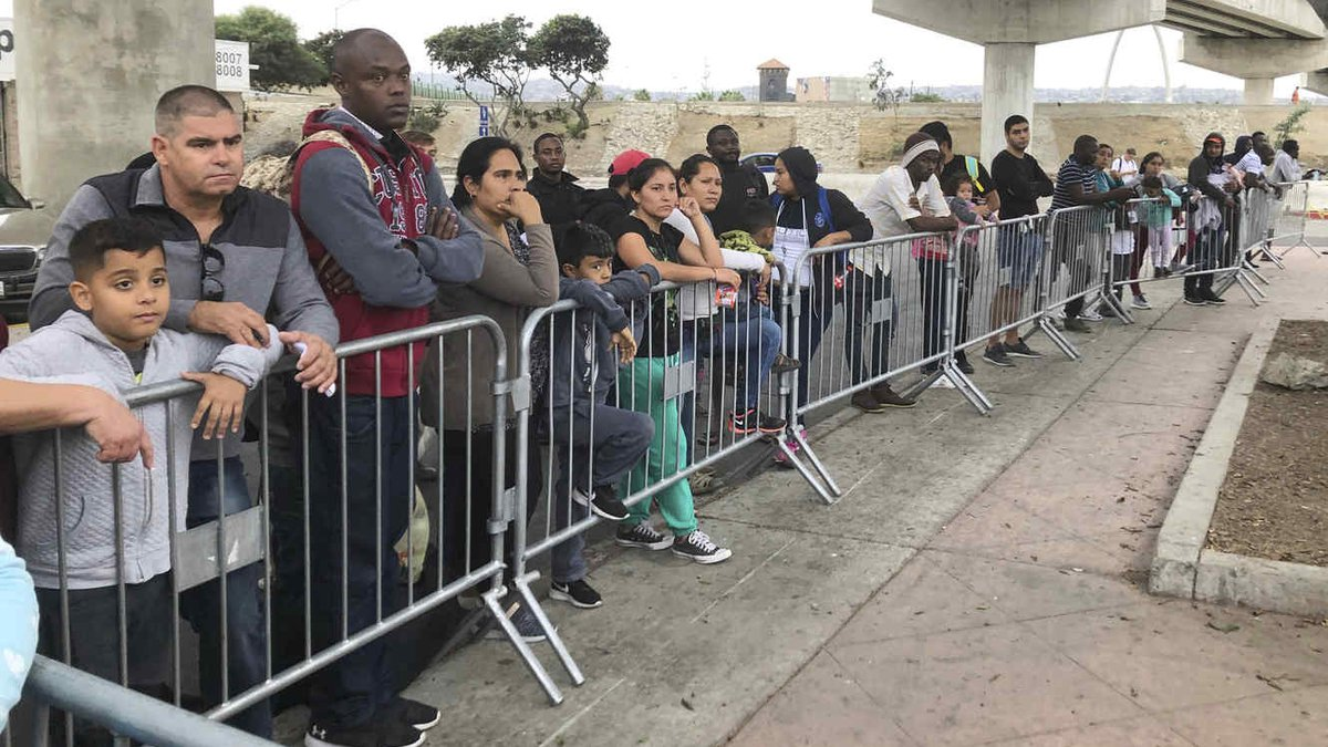 Small numbers of migrants are allowed into the U.S. every day under an opaque system that the...