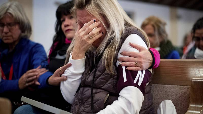 Laura Martin mourns her father, TK Huff, who died during the Camp Fire, during a vigil on...