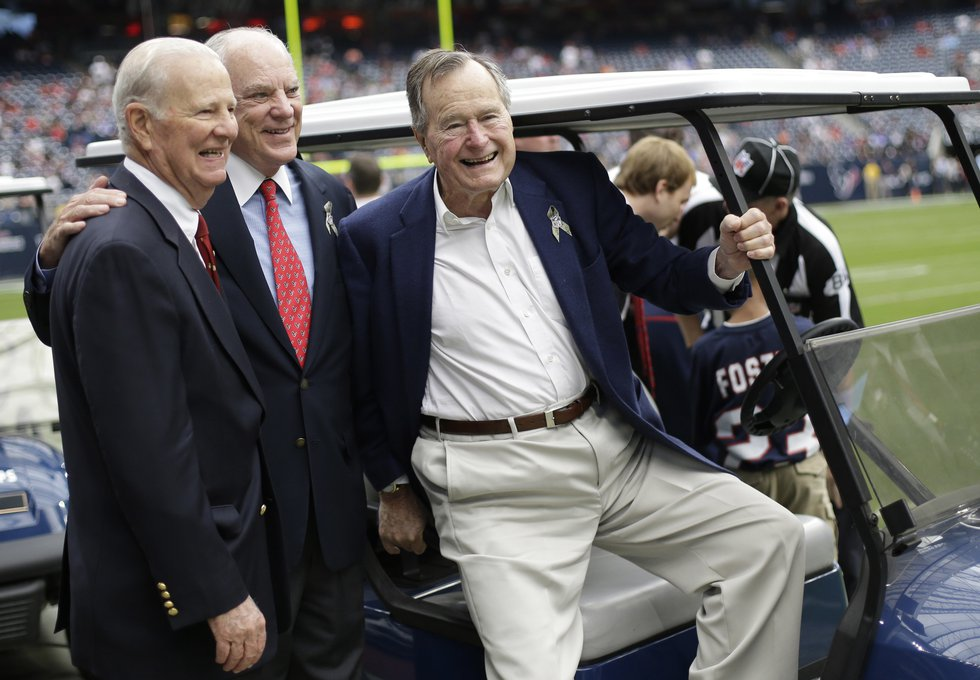 In this Nov. 4, 2012, photo, former President George H. W. Bush, right, former Secretary of...