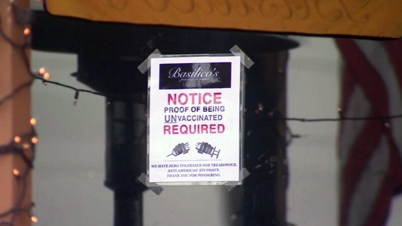 A California restaurant is receiving backlash for flyers requiring proof that customers are not...