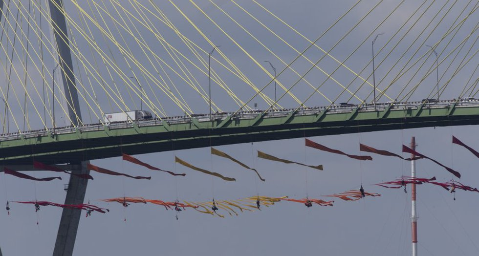 Greenpeace USA protesters dangle from the Fred Hartman Bridge, Thursday, Sept. 12, 2019, in...