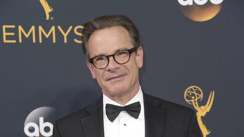 FILE - Peter Scolari arrives at the 68th Primetime Emmy Awards in Los Angeles on Sept. 18,...