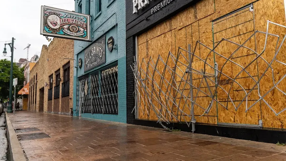 Workers boarded up bars on Sixth Street in Austin after Gov. Greg Abbott closed bars in Texas...