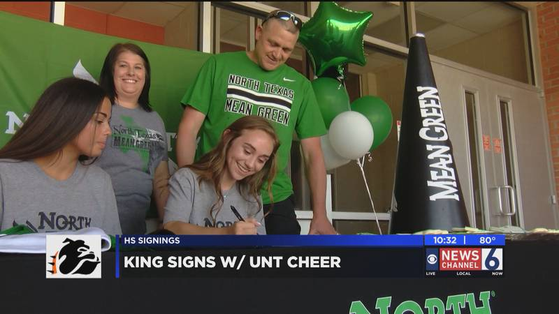 Burkburnett's Lexi King signs for cheer at UNT.