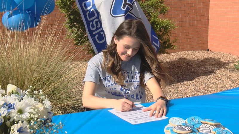 Ambree Anderle signed for college volleyball in a fun drive-by celebration.