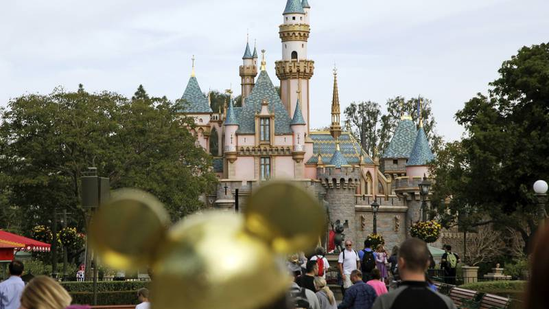 FILE - In this Jan. 22, 2015, file photo, visitors walk toward Sleeping Beauty's Castle in the...