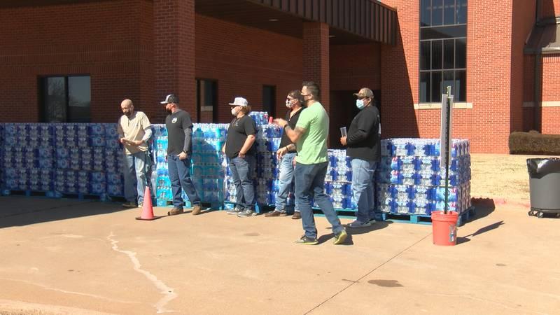 Evangel Church distributes cases of bottled water