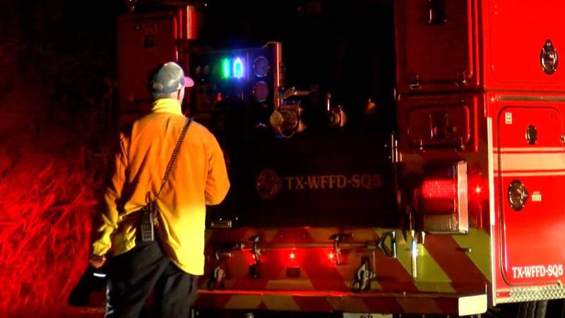 Firefighters extinguish grass fire at Lake Wichita Park