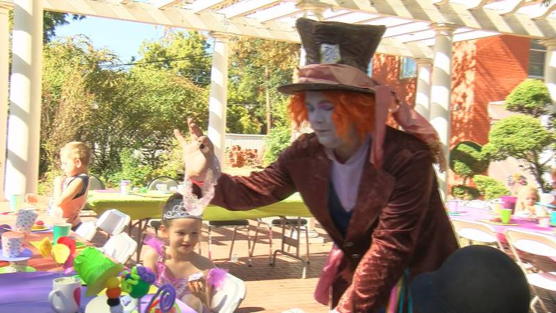 Families enjoyed punch and cupcakes as they watched the iconic tea party scene