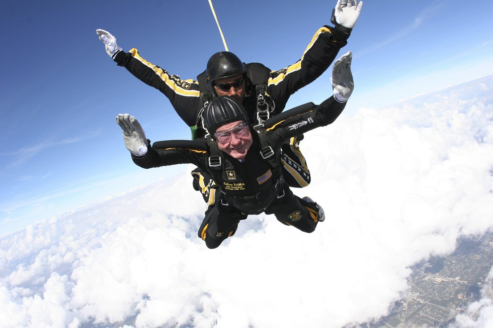 In this Nov. 10, 2007, photo provided by the U.S. Army Golden Knights, former President George...