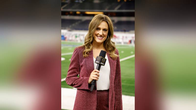 Allison Williams, sideline reporter with ESPN poses for a photo on the field at AT&T Stadium...