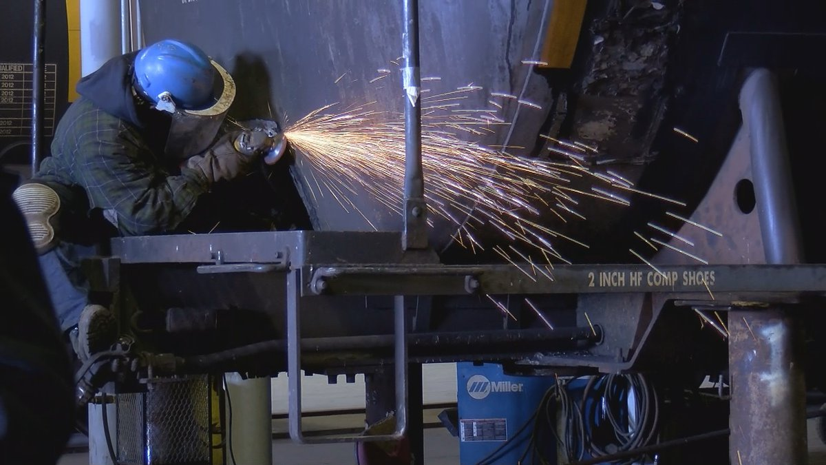 A worker works on one of the railcars at the plant.