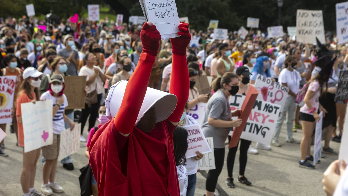 FILE - In this Oct. 2, 2021 file Cindy Gomez, of Austin, attends the Women's March ATX rally,...