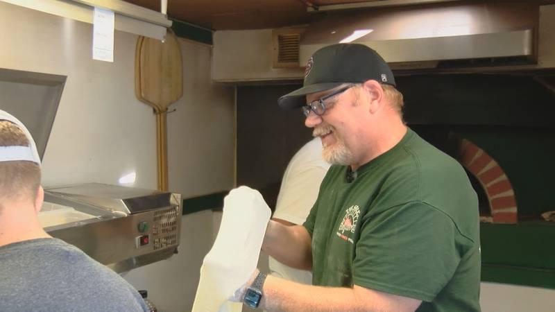 Seymour football coach Hugh Farmer runs a pizza food truck during the off season.