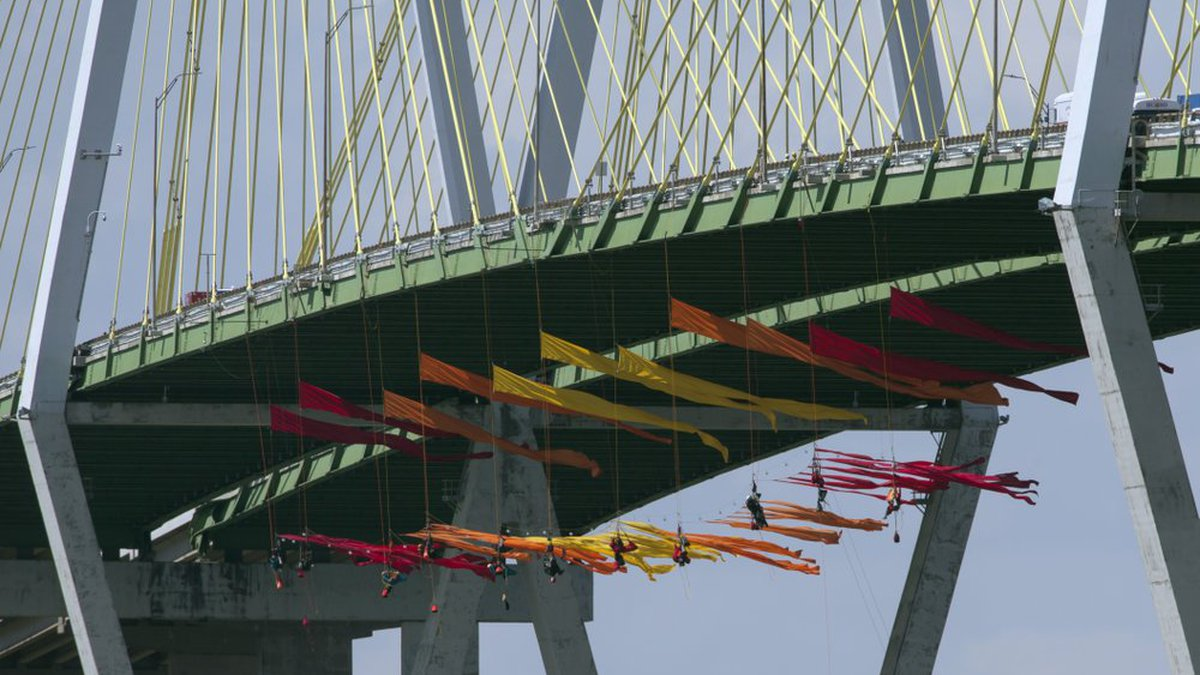 Greenpeace USA protesters dangle from the Fred Hartman Bridge Thursday, Sept. 12, 2019, in...
