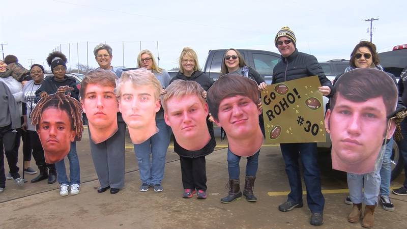 A large crowd gave the Rider Raiders football team a send off outside the high school before...