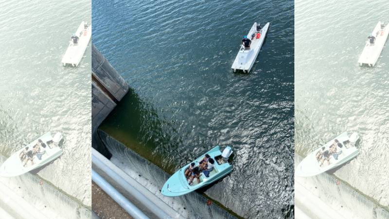 Rescue crews in Central Texas saved a group of people in a boat about to fall over the edge of...