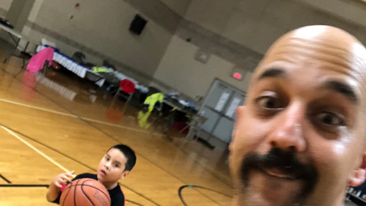 Moose Mustafa made time to play with some children at a shelter after a long day assisting in...
