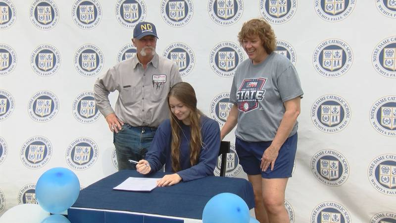 Notre Dame's Reagan Macha signed her letter of intent in her backyard Monday afternoon.