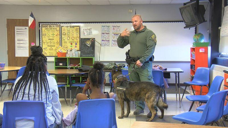 Wichita County Sheriff's K-9 deputy teaches students about his job.